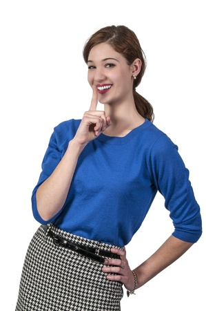 hushed: A woman saying be quiet by saying shhh Stock Photo