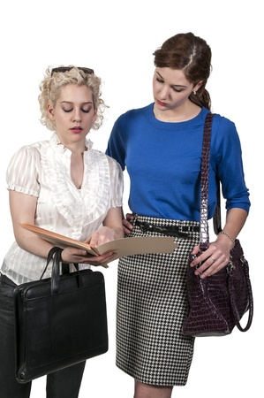 collaborating together: Beautiful business women collaborating together on a project Stock Photo