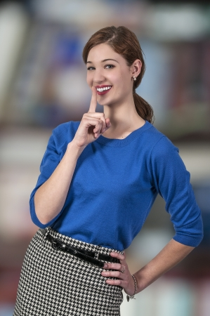 A woman saying be quiet by saying shhh Stock Photo - 19784451