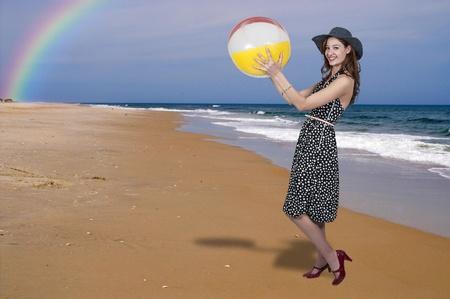 Beautiful young woman holding a beachball photo