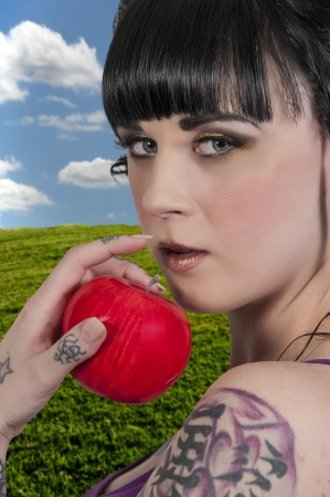 winesap apple: Beautiful woman eating a whole red delicious apple