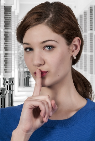 A woman saying be quiet by saying shhh Stock Photo - 19783929