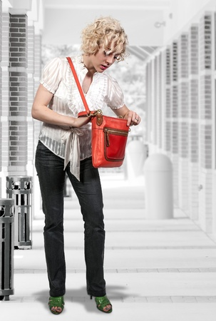 ransack: Beautiful woman looking through her pocket book purse Stock Photo