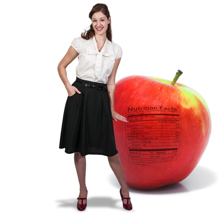 winesap apple: Beautiful woman standing beside a whole red delicious apple with a nutrition label