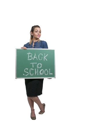Woman holding a chalkboard that says back to school photo
