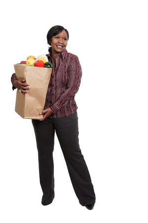 grocery bag: Beautiful young woman with a brown paper shopping bag