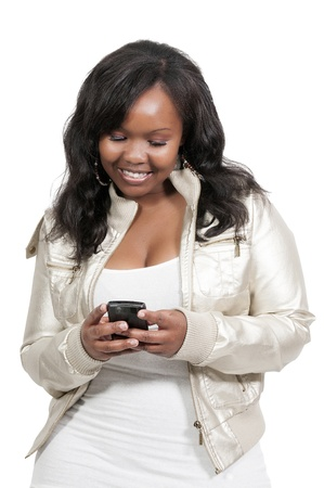 Beautiful young woman using a cell phone for texting photo