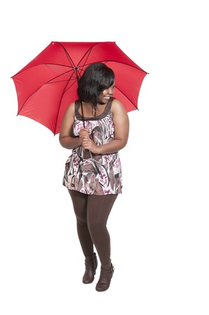 Beautiful young woman holding an umbrella in the rain