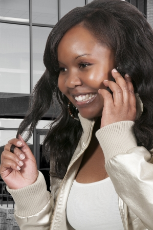 Beautiful woman talking on a cell phone photo