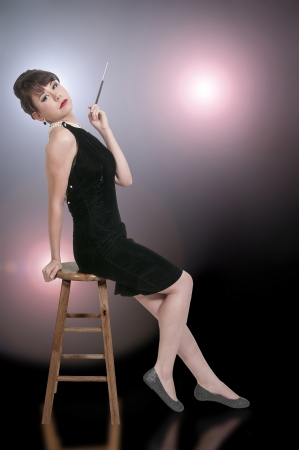 Beautiful young attractive woman movie star modeling a pose photo