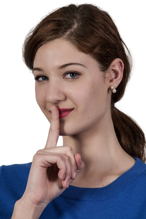 shhh: A woman saying be quiet by saying shhh Stock Photo