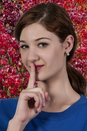 A woman saying be quiet by saying shhh Stock Photo - 20883815
