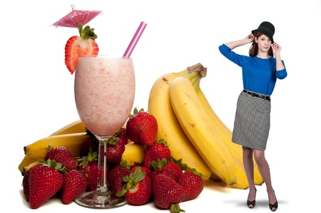 Beautiful woman with a delicious cold Fruit Smoothie or daiquiri and fruit photo