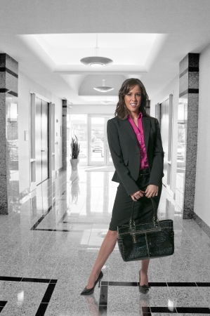 upwardly mobile: A beautiful young upwardly mobile business woman