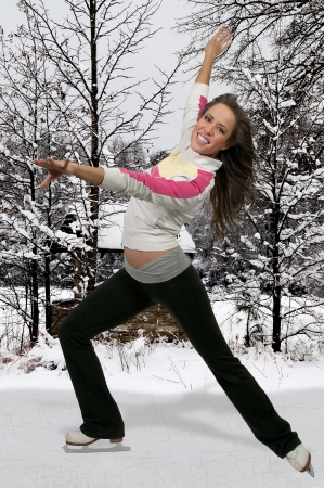 Beautiful young woman figure skater on ice skates photo