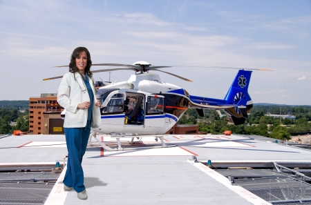 Woman doctor and a mobile flying ambulance better known as a life flight Stok Fotoğraf