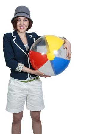 beachball: Beautiful young woman holding a beachball