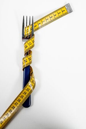 Tailors measuring tape coiled up randomly photo