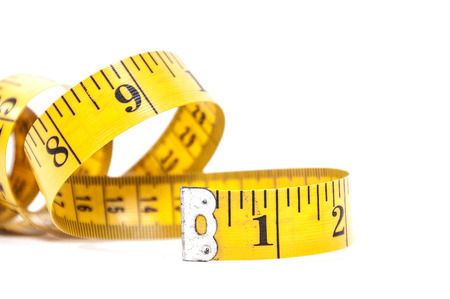 Tailors measuring tape coiled up randomly Stockfoto