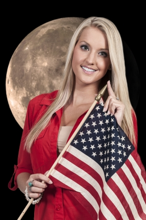 Beautiful young woman holding an American flag. Stock Photo - 24558966
