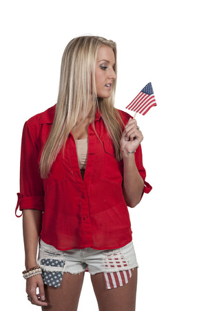 Beautiful young woman holding an American flag. photo