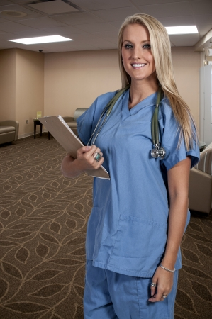 Beautiful young female doctor on her rounds photo