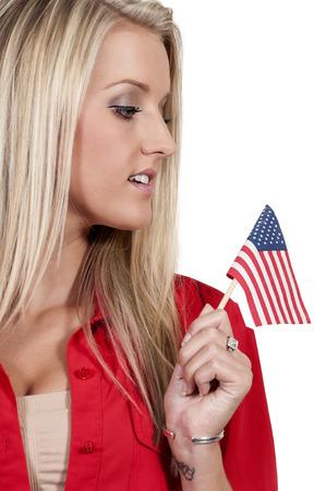 tatt: Beautiful young woman holding an American flag. Stock Photo