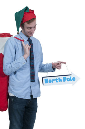 Handsome man elf holding a north pole sign photo