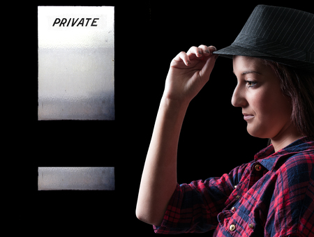 private i: Beautiful young woman in a fedora hat Stock Photo