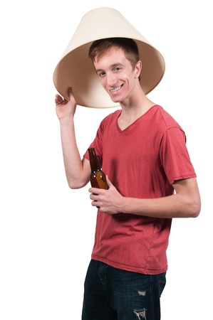 Man drinking adult beverages at a party wearing a lampshade photo