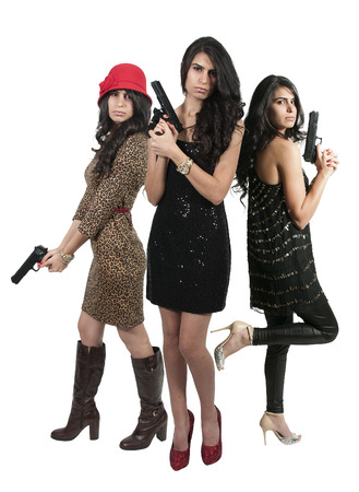 Beautiful police detective women on the job with guns photo