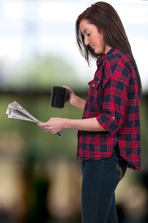 listings: Beautiful young woman drinking coffee in the morning