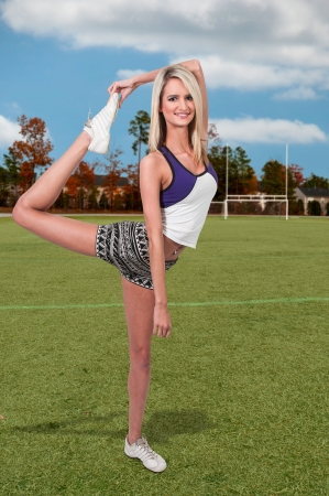 Beautiful young woman in a cheerleading uniform photo