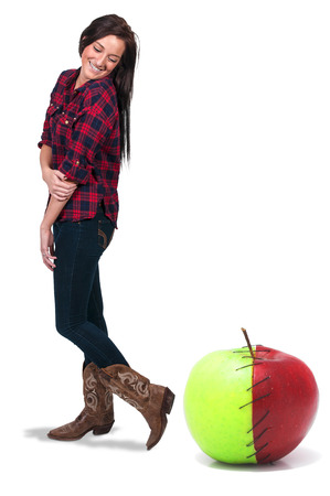winesap apple: Beautiful woman standing beside a red and green apple stitched together