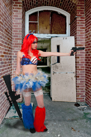 Woman dressed to go to a rave dance party with guns photo