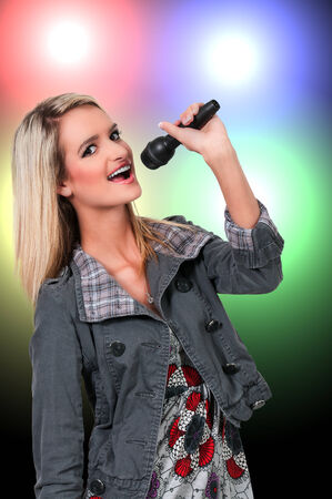Beautiful woman singer performing at a concert photo