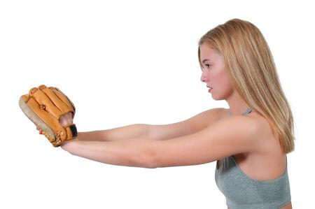 Beautiful woman catchinging a baseball at a ball field photo