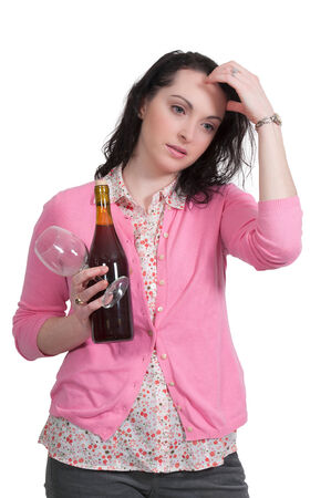 homemaker: Beautiful woman holding a bottle of wine