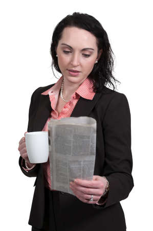 Beautiful young upwardly mobile business woman with coffee photo