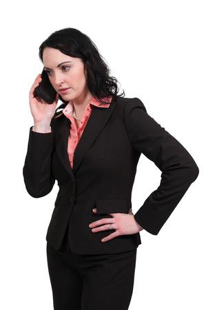 Beautiful woman talking on a cell phone Фото со стока