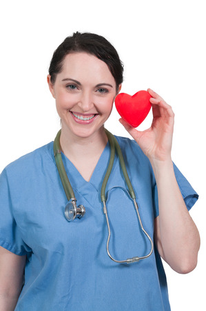 Beautiful young woman cardiology surgeon holding a heart photo
