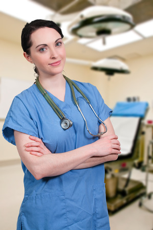 obgyn: Beautiful young female doctor on her rounds Stock Photo