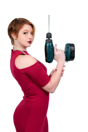 Beautiful woman holding a battery powered electric cordless drill photo