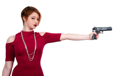 Beautiful police detective woman on the job with a gun photo