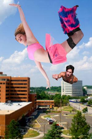 flying man: man saving a falling woman in the sky Stock Photo