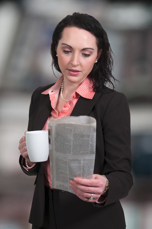 Beautiful young upwardly mobile business woman with coffee
