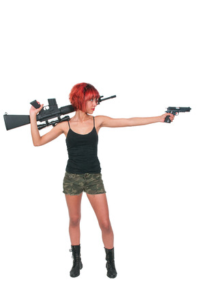Beautiful young woman holding an automatic assault rifle and pistol photo