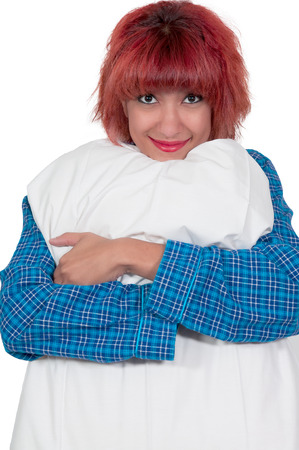 Beautiful young attractive womanholding a pillow Stock Photo