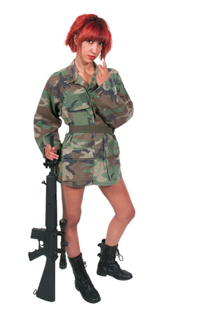 come hither: Beautiful young woman holding an automatic assault rifle