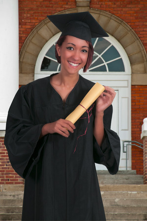 Young woman in her graduation robes photo
